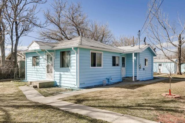 7031 Holly Street, Commerce City, CO 80022 (#6969242) :: The Peak Properties Group