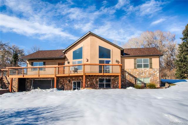 9155 W 73rd Place, Arvada, CO 80005 (#7035601) :: The Peak Properties Group
