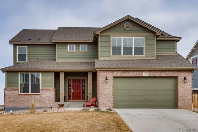 8776 Bross Street W, Arvada, CO 80007 (#7102101) :: The Griffith Home Team