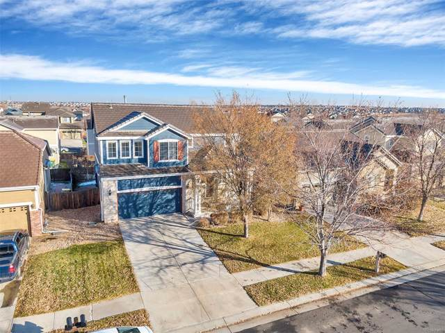 15765 E 97th Avenue, Commerce City, CO 80022 (#7139042) :: The Peak Properties Group