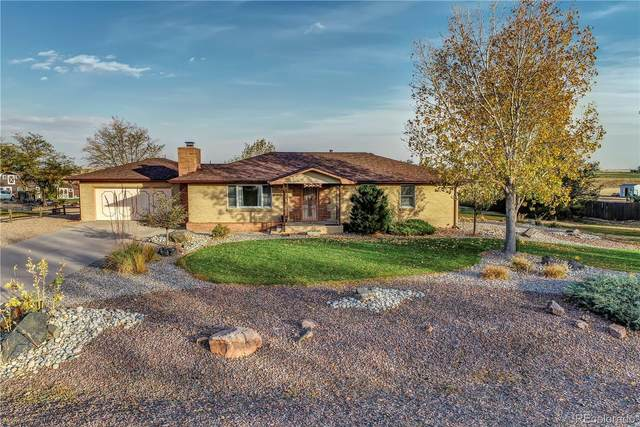 14160 Country Hills Drive, Brighton, CO 80601 (#7180562) :: The DeGrood Team