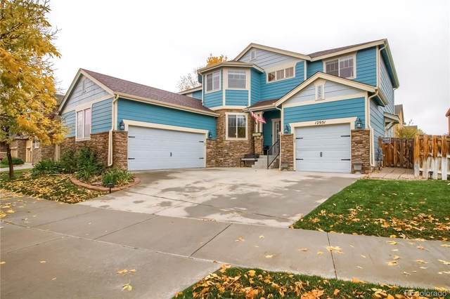 12951 E 107th Avenue, Commerce City, CO 80022 (#7184052) :: Hudson Stonegate Team