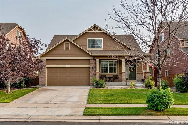11404 E 111th Avenue, Commerce City, CO 80640 (#7202431) :: Kimberly Austin Properties