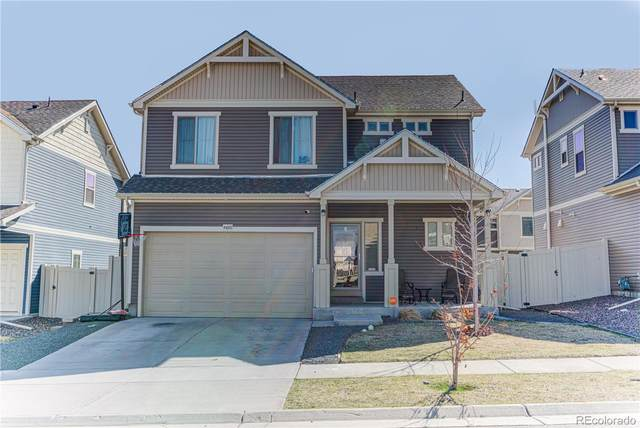 4420 Uravan Street, Denver, CO 80249 (#7209967) :: The Griffith Home Team