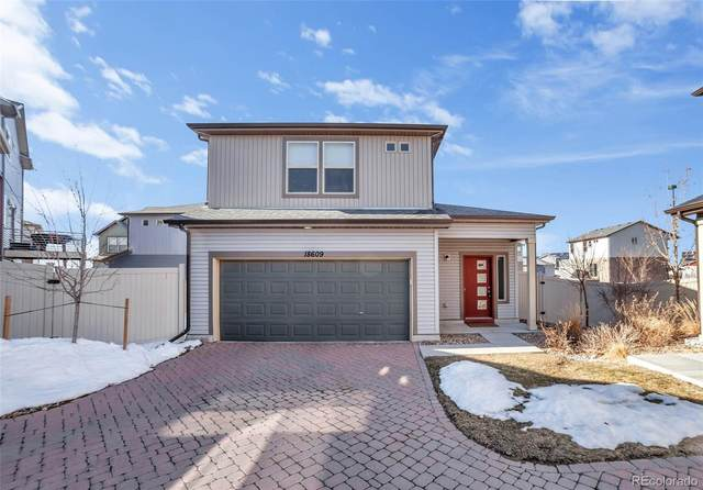 18609 E 50th Place, Denver, CO 80249 (#7267472) :: Hudson Stonegate Team