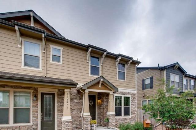 14837 W 69th Drive B, Arvada, CO 80007 (#7339276) :: The DeGrood Team
