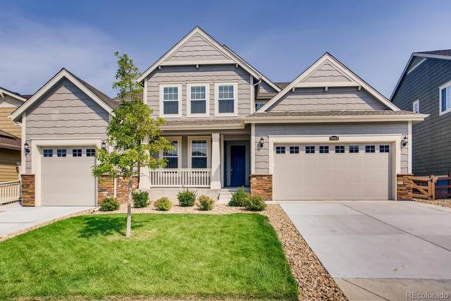19904 W 94th Lane, Arvada, CO 80007 (#7434710) :: The HomeSmiths Team - Keller Williams
