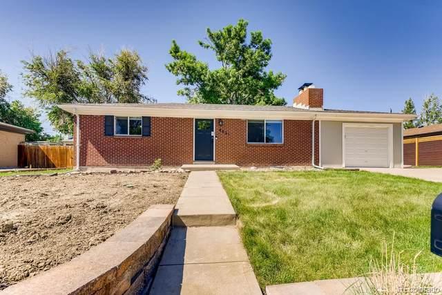 8621 W 64th Place, Arvada, CO 80004 (#7447512) :: iHomes Colorado