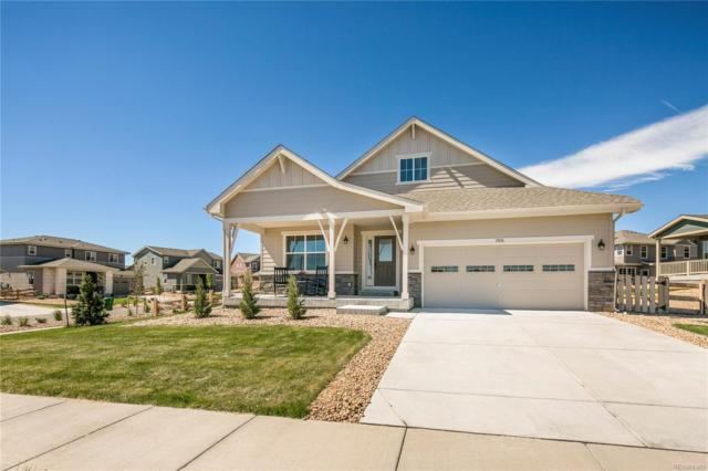 19876 W 94th Avenue, Arvada, CO 80007 (#7510690) :: The Peak Properties Group