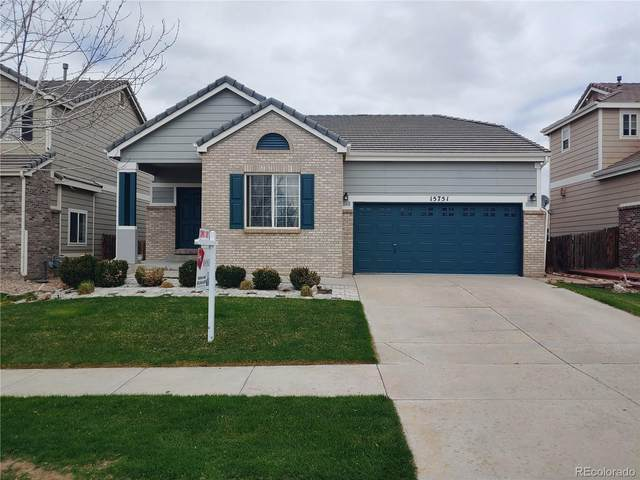 15751 E 96th Place, Commerce City, CO 80022 (#7557334) :: The Healey Group