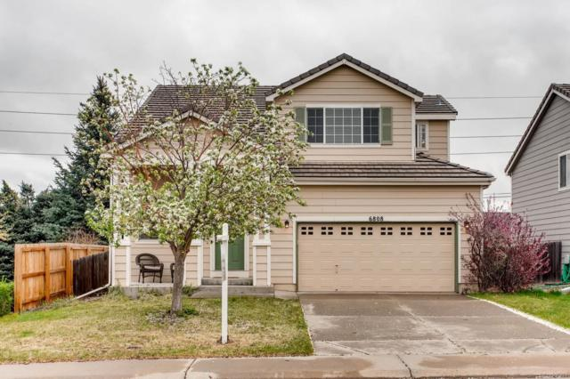 6808 W Chatfield Place, Littleton, CO 80128 (#7704657) :: The Pete Cook Home Group