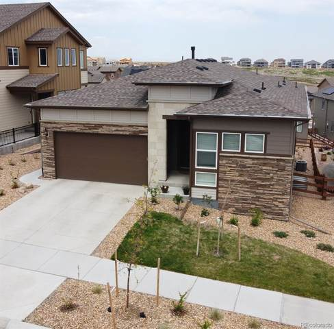 18709 W 92nd Drive, Arvada, CO 80007 (#7706306) :: The Gilbert Group