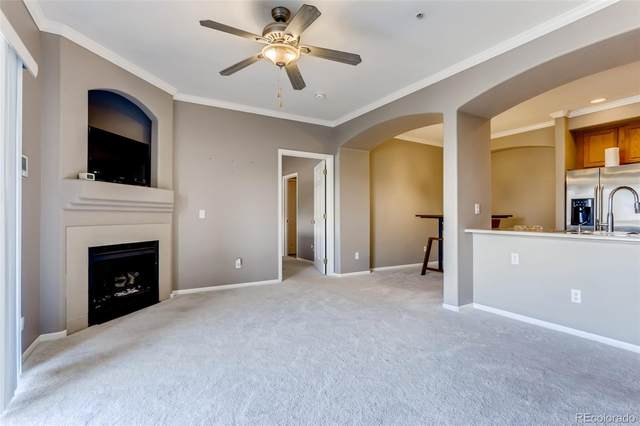 1801 S Dunkirk Street #202, Aurora, CO 80017 (#7753467) :: Portenga Properties - LIV Sotheby's International Realty