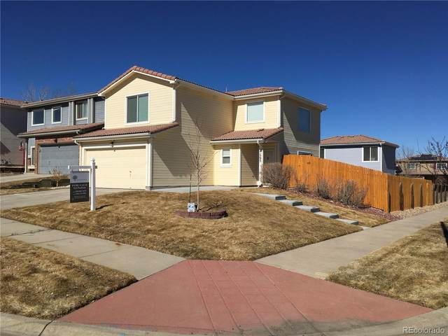 21595 E 39th Avenue, Denver, CO 80249 (#7767339) :: Hudson Stonegate Team