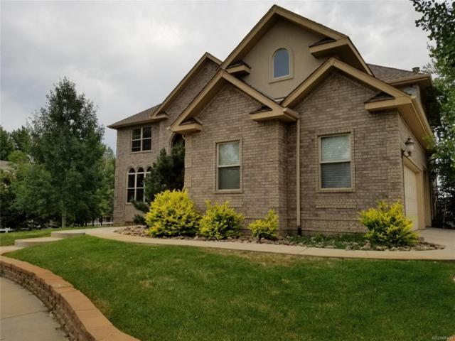 14111 W 63rd Place, Arvada, CO 80004 (#7851038) :: The Griffith Home Team