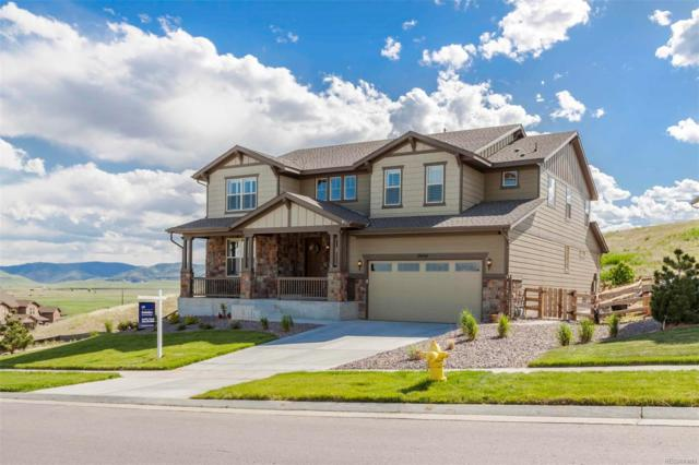 19434 W 85th Bluff, Arvada, CO 80007 (#7888220) :: The Healey Group