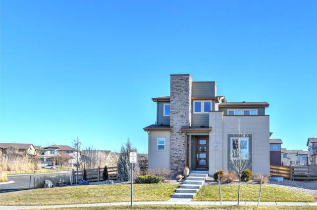 10122 Southlawn Circle, Commerce City, CO 80022 (#7897211) :: House Hunters Colorado