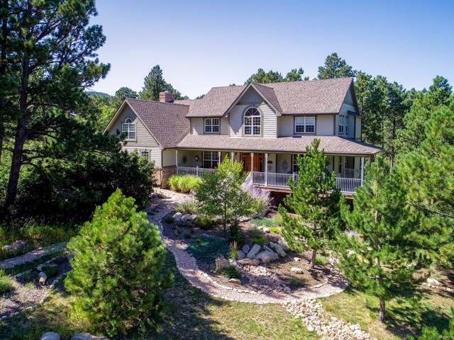 14385 Woodcrest Circle, Larkspur, CO 80118 (#7923100) :: The Peak Properties Group