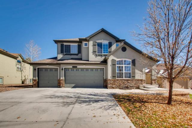 12485 W 77th Drive, Arvada, CO 80005 (#7932073) :: The Healey Group