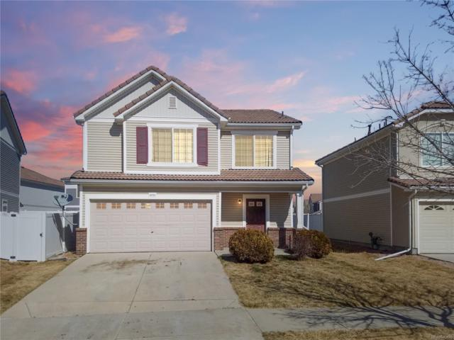 19703 E 55th Place, Denver, CO 80249 (#7949275) :: The Peak Properties Group