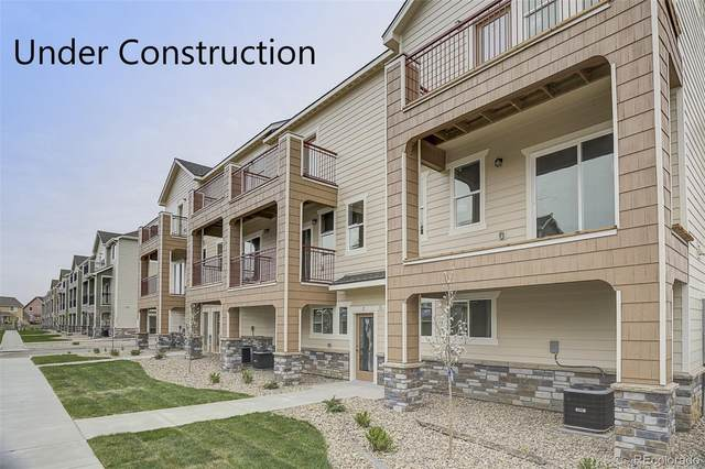 11250 Florence Street 23E, Commerce City, CO 80640 (#7977552) :: The DeGrood Team