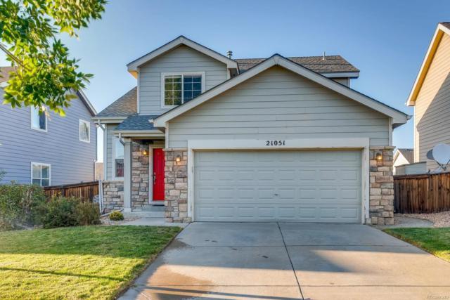 21051 E 40th Avenue, Denver, CO 80249 (#8032612) :: Ben Kinney Real Estate Team