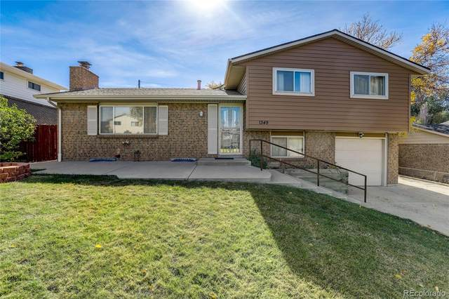 1349 Chambers Road, Aurora, CO 80011 (#8055824) :: You 1st Realty