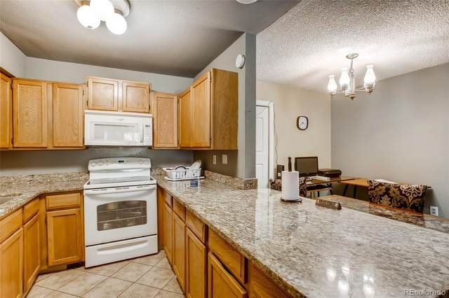 2280 S Oswego Way #101, Aurora, CO 80014 (#8063278) :: Compass Colorado Realty