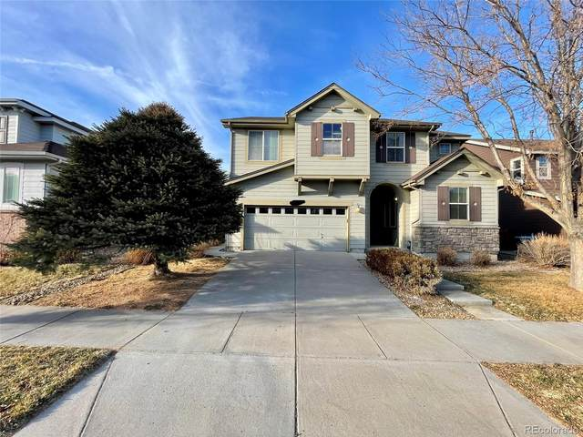 17661 E 104th Place, Commerce City, CO 80022 (#8082165) :: The Gilbert Group