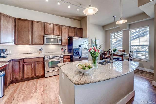 10111 Inverness Main Street #214, Englewood, CO 80112 (#8089094) :: Bring Home Denver with Keller Williams Downtown Realty LLC