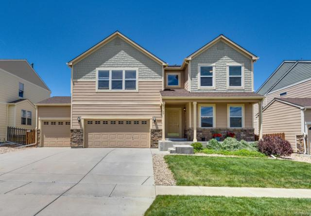 10149 Granby Drive, Commerce City, CO 80022 (#8104276) :: The Tamborra Team