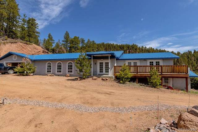 13965 Woodmoor West Drive, Larkspur, CO 80118 (#8123061) :: The Gilbert Group