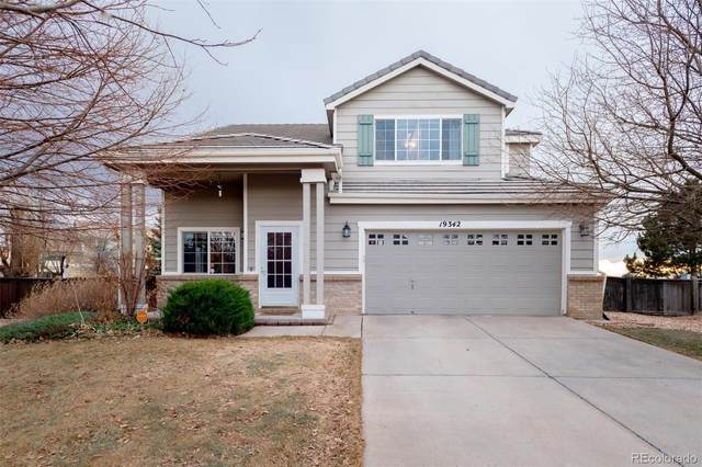 19342 E 58th Place, Aurora, CO 80019 (#8142011) :: Bring Home Denver with Keller Williams Downtown Realty LLC