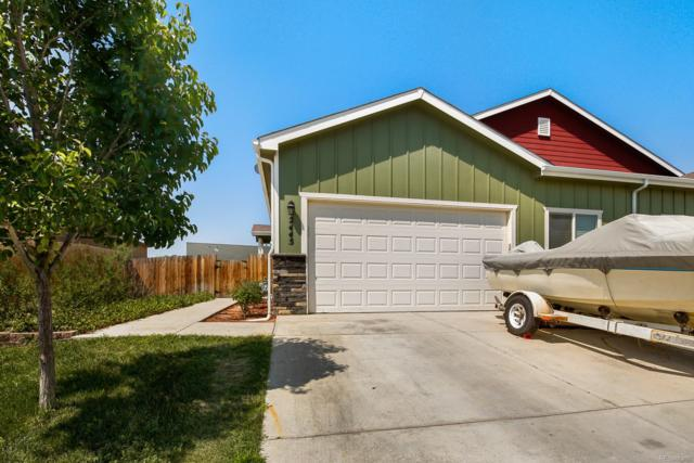 2445 School House Drive, Milliken, CO 80543 (#8143353) :: The City and Mountains Group