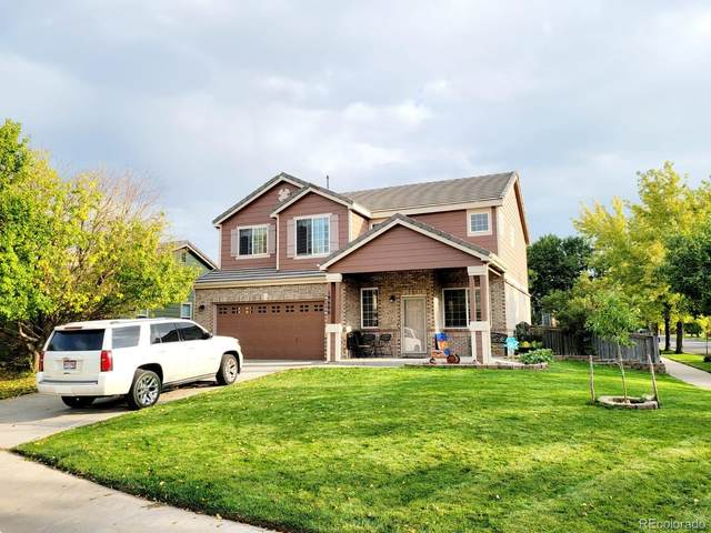 19600 E 59th Drive, Aurora, CO 80019 (#8150107) :: HomeSmart Realty Group