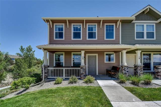 15612 E 96th Way 11A, Commerce City, CO 80022 (#8156557) :: The Healey Group