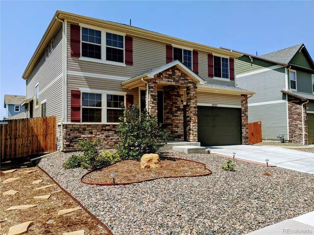 10757 Wheeling Drive, Commerce City, CO 80022 (#8259649) :: The Brokerage Group