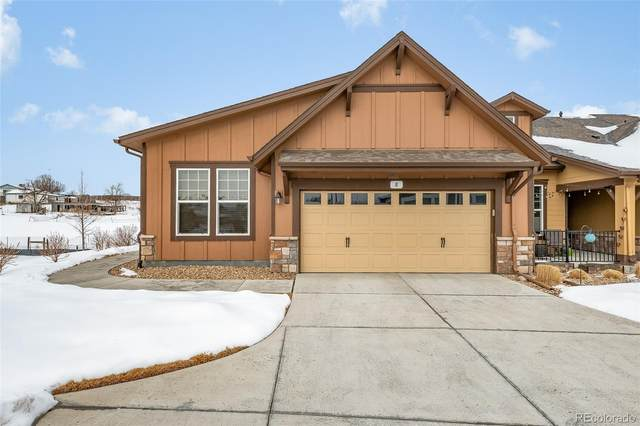 14447 W 88th Place E, Arvada, CO 80005 (#8326250) :: The Healey Group