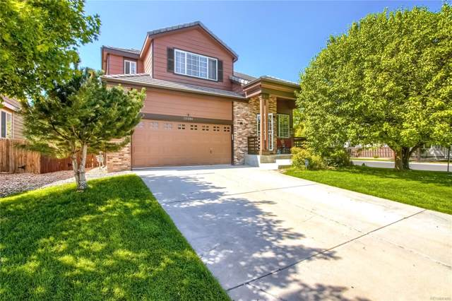 15584 E 97th Avenue, Commerce City, CO 80022 (#8339460) :: The Peak Properties Group