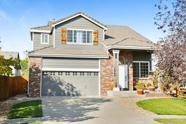 14289 E 101st Place, Commerce City, CO 80022 (#8371658) :: My Home Team