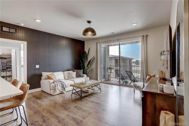 15385 W 64th Lane #303, Arvada, CO 80007 (MLS #8376074) :: Bliss Realty Group