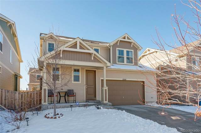 12424 E 105th Way, Commerce City, CO 80022 (#8378762) :: The Heyl Group at Keller Williams