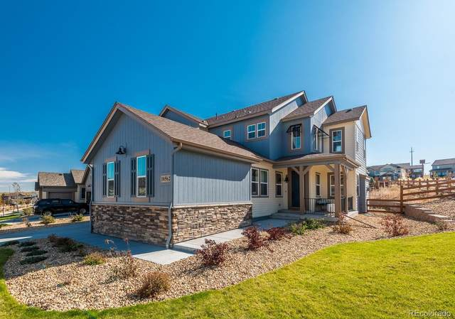 18562 W 93 Place, Arvada, CO 80007 (#8385182) :: The Griffith Home Team