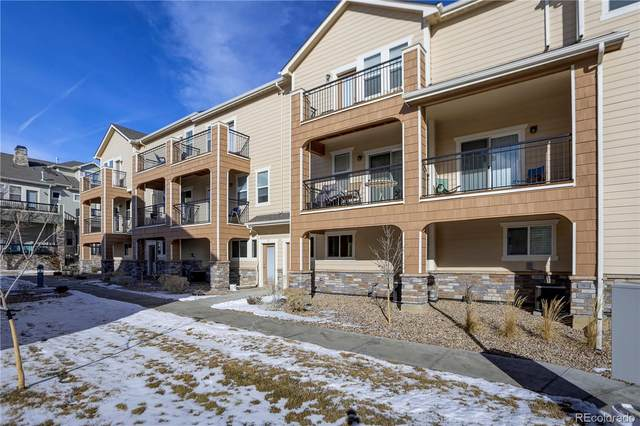 11250 Florence Street 10D, Commerce City, CO 80640 (#8411182) :: Briggs American Properties