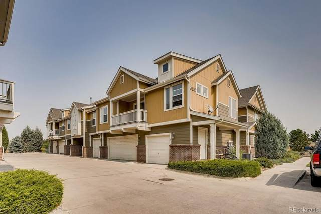 11959 Riverstone Circle 8D, Commerce City, CO 80640 (#8412405) :: The Healey Group