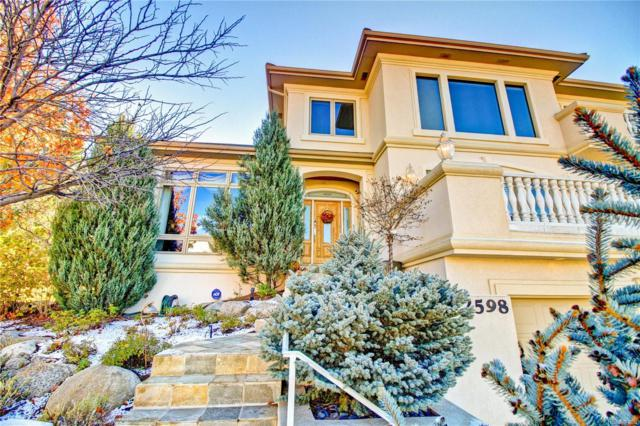 2598 S Harlan Court, Lakewood, CO 80227 (#8476749) :: The Pete Cook Home Group