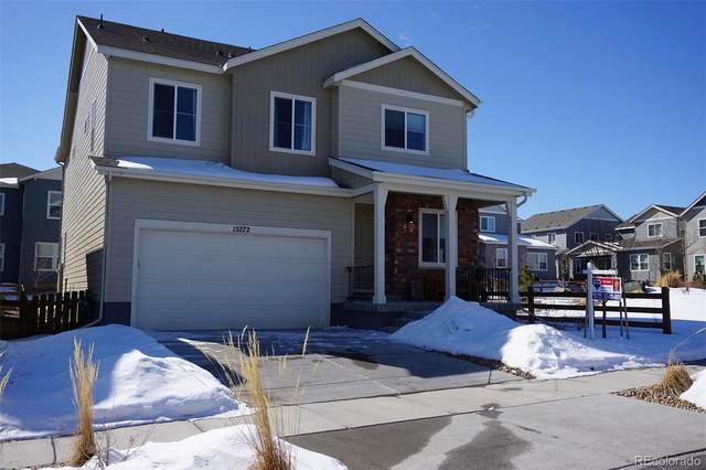 15272 W 93rd Place, Arvada, CO 80007 (#8535288) :: The Peak Properties Group
