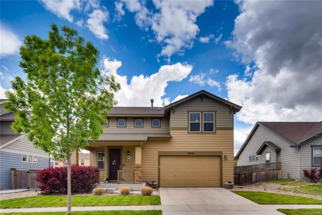 15992 Village Circle, Commerce City, CO 80603 (#8547315) :: The Heyl Group at Keller Williams