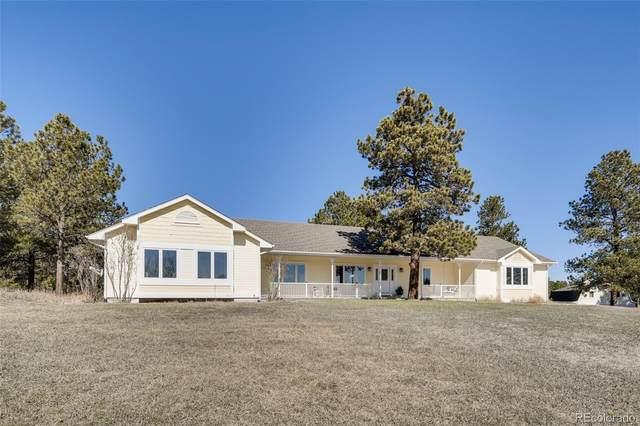 15180 W Coachman Drive, Colorado Springs, CO 80908 (#8590774) :: iHomes Colorado