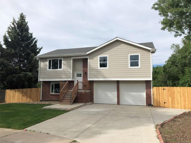 8766 W 66th Place, Arvada, CO 80004 (#8595776) :: The Dixon Group